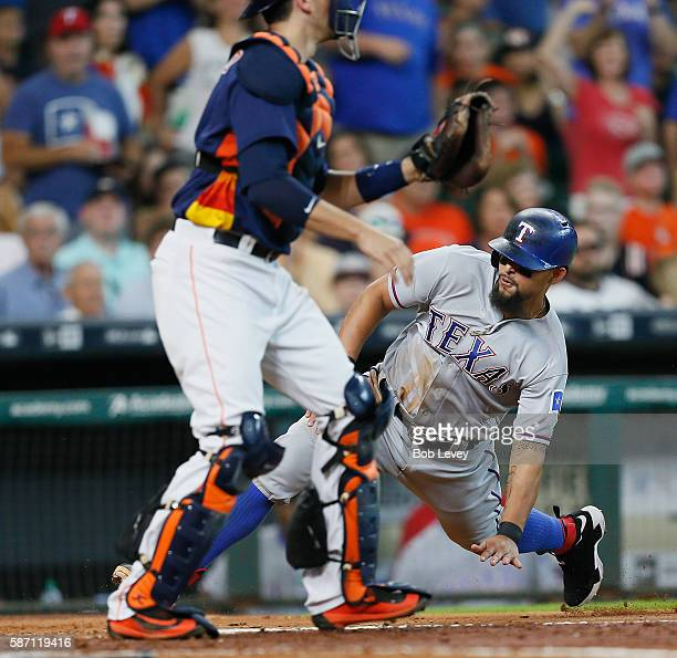 Rougned Odor of the Texas Rangers scores in the fifth inning on a double by Jonathan Lucroy at Minute Maid Park on August 7 2016 in Houston Texas