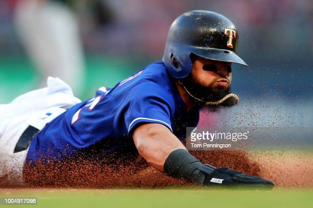 Rougned Odor of the Texas Rangers slides safe into third base against the Oakland Athletics in the bottom of the second inning at Globe Life Park in...