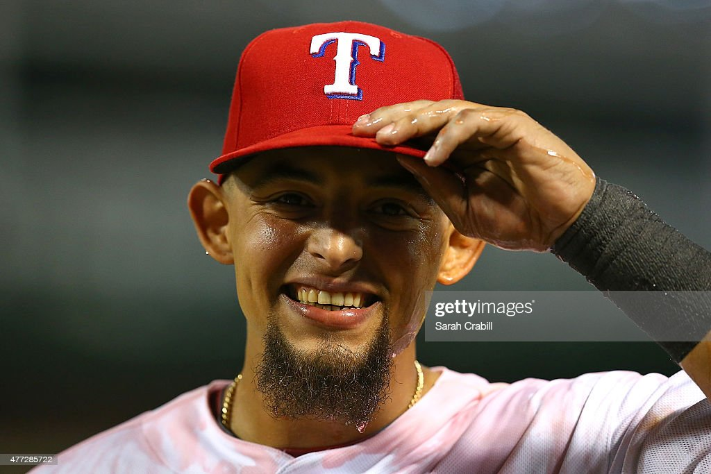 Rougned Odor #12 of the Texas Rangers smiles after being dunked with Gatorade after a game against the Los Angeles Dodgers at Globe Life Park in Arlington on June 15, 2015 in Arlington, Texas. The Texas Rangers defeated the Los Angeles Dodgers 4-1.