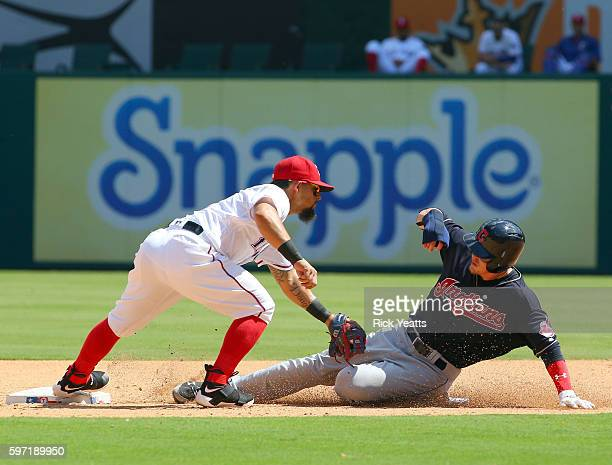 Rougned Odor of the Texas Rangers tags out Brandon Guyer of the Cleveland Indians in the fifth inning on second base at Globe Life Park in Arlington...