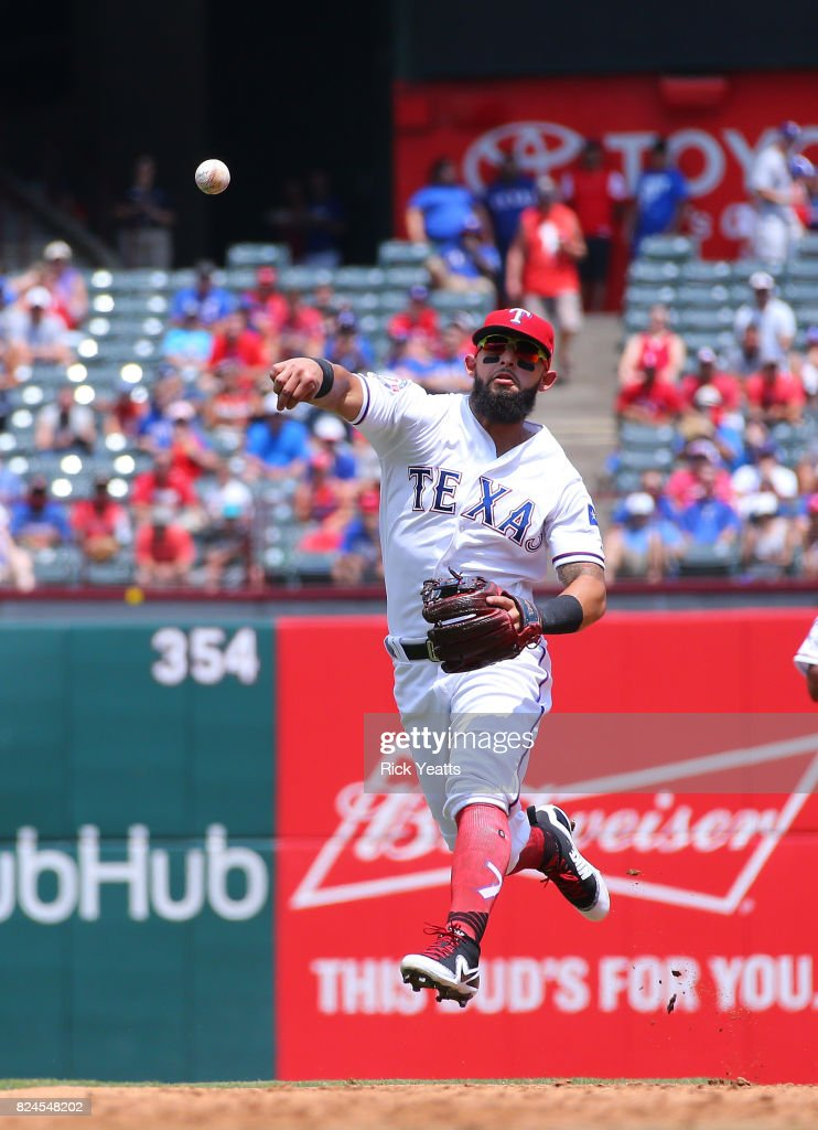 Rougned Odor #12 of the Texas Rangers throw the runner out on first base in the third inning against the Baltimore Orioles at Globe Life Park in Arlington on July 30, 2017 in Arlington, Texas.