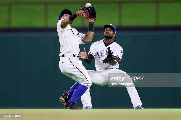 Rougned Odor of the Texas Rangers tries to field a fly ball and colides with Delino DeShields of the Texas Rangers in the top of the eighth inning...