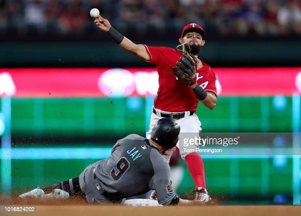 Rougned Odor of the Texas Rangers turns a double play against Jon Jay of the Arizona Diamondbacks in the top of the fourth inning at Globe Life Park...
