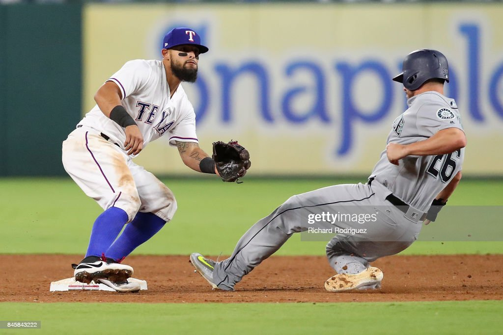 Rougned Odor #12 of the Texas Rangers waits for the throw as Danny Valencia #26 of the Seattle Mariners steals second in the sixth inning of a game at Globe Life Park in Arlington on September 11, 2017 in Arlington, Texas.