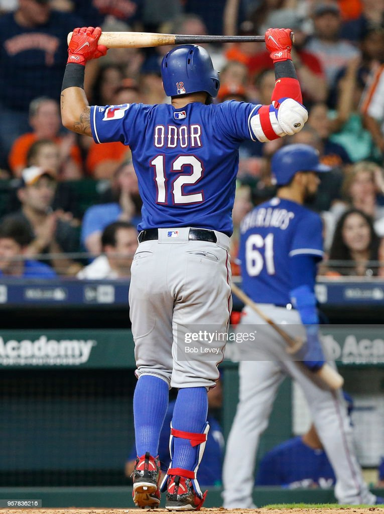 Rougned Odor #12 of the Texas Rangers walks back to the dugout after striking out in the seventh inning against the Houston Astros at Minute Maid Park on May 12, 2018 in Houston, Texas.