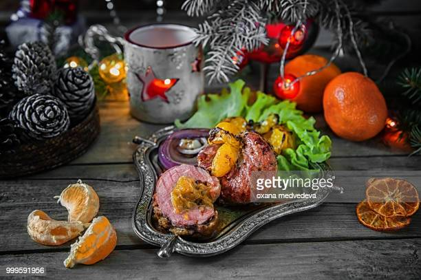 Roulade of duck breast fillets stuffed with Mandarin oranges, red onions and grilled mandarins on...