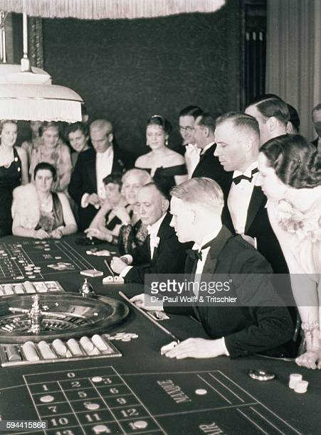 Roulette table and people in a casino