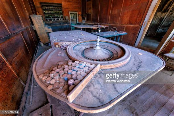 roulette table in abandoned bar, bodie, california, usa - weinstein stock pictures, royalty-free photos & images