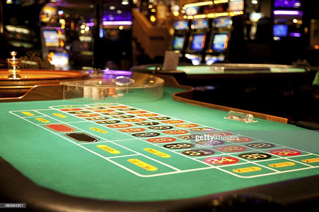 Roulette table in the casino : Stock Photo