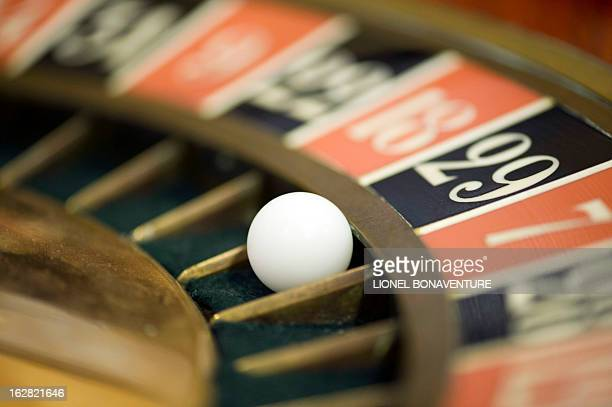 A roulette table is pictured in the Cerus Casino Academy a school for croupiers in Paris on February 27 2013 AFP PHOTO / LIONEL BONAVENTURE