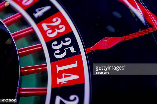 A roulette wheel glows during the 2016 Global Gaming Expo at the Las Vegas Sands Corp Expo and Convention Center in Las Vegas Nevada US on Tuesday...