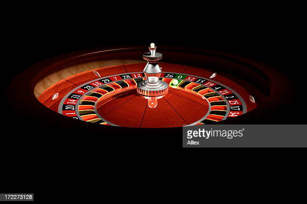 Roulette wheel in a dark casino