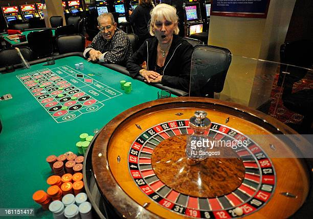 Richard Lopes of Denver left and Cindy Rpzmarich of Aurora watch as the ball comes to a stop on the roulette wheel at The Gilpin Casino in Black Hawk...