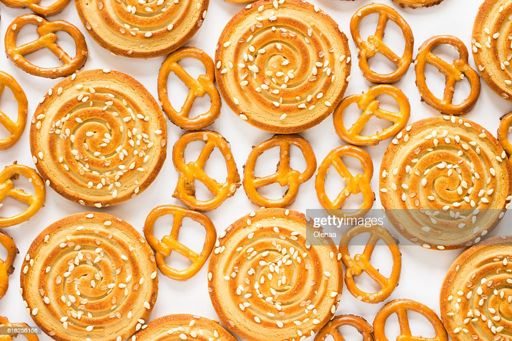 Round cookies with sesame seeds and figured cookies. Top view : Stock Photo