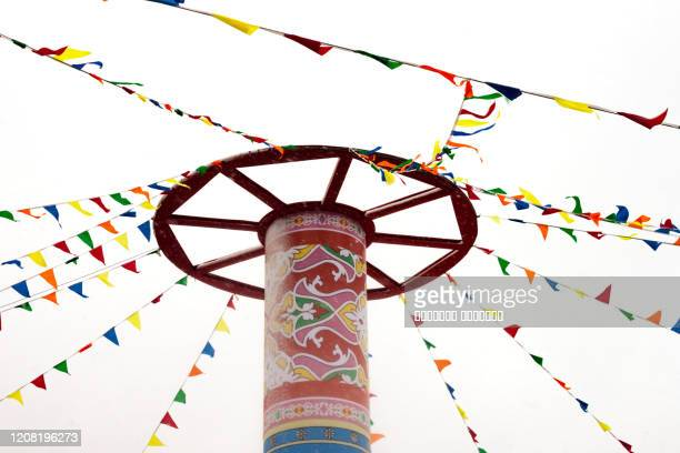 round high post with multycolored flags shrovetide carnival pancake week russian holiday maslenitsa concept - orthodox christmas stock pictures, royalty-free photos & images