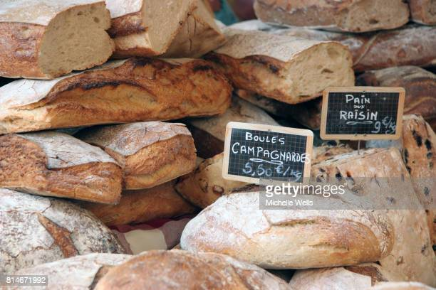round loaves of bread with price