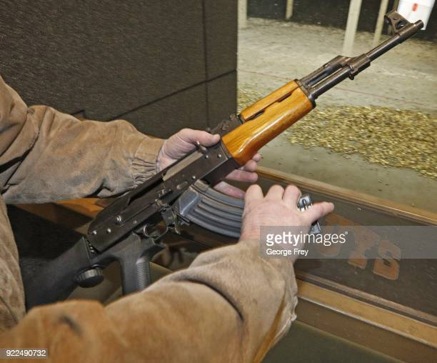 A 30 round magazine is loaded into an AK47 with a bump stock installed at Good Guys Gun and Range on February 21 2018 in Orem Utah The bump stock is...
