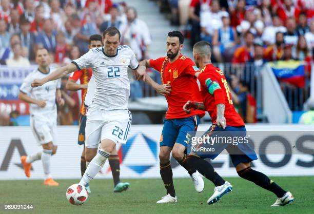 Round of 16 Russia v Spain FIFA World Cup Russia 2018 Artem Dzyuba and Sergi Busquets at Luzhniki Stadium in Moscow Russia on July 1 2018