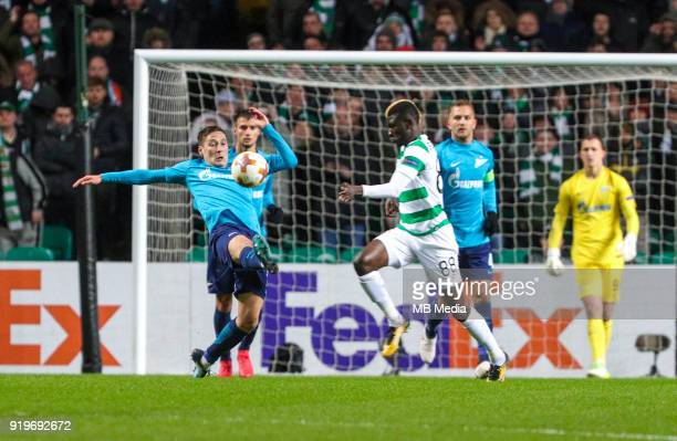Round of 32 match between Celtic and Zenit St Petersburg at the Celtic Park Glasgow United Kingdom Daler Kuzyaev of Zenit St Petersburg and Kouassi...