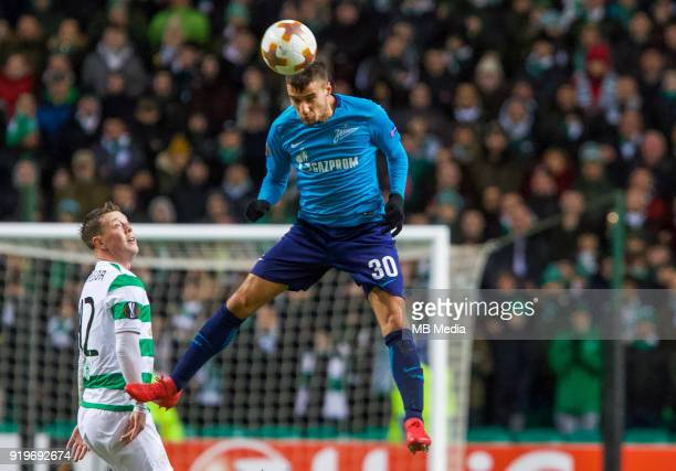 Round of 32 match between Celtic and Zenit St Petersburg at the Celtic Park Glasgow United Kingdom Callum McGregor of Celtic and Emanuel Mammana of...