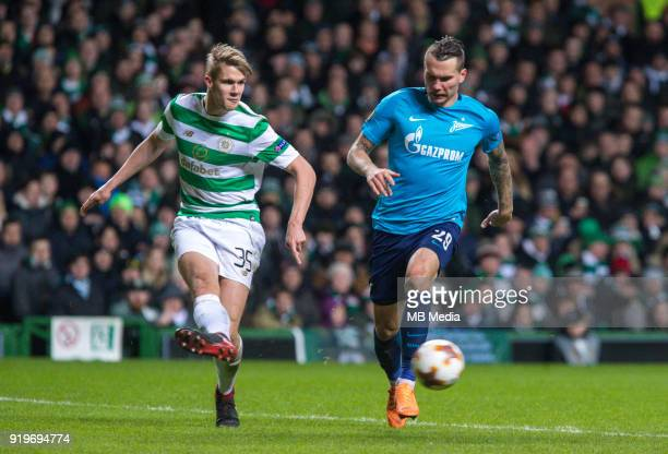 Round of 32 match between Celtic and Zenit St Petersburg at the Celtic Park Glasgow United Kingdom Kristoffer Ajer of Celtic and Anton Zabolotny of...