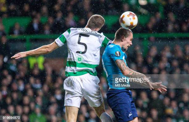 Round of 32 match between Celtic and Zenit St Petersburg at the Celtic Park Glasgow United Kingdom Jozo Simunovic of Celtic and Anton Zabolotny of...