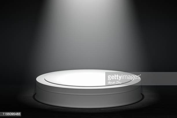 round podium with spotlight,3d render - winners podium stock pictures, royalty-free photos & images