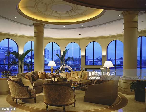 Round Seating Area with View Through Arched Windows