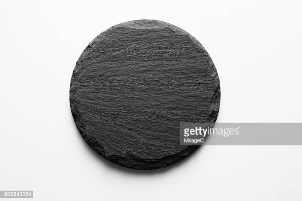 round shape slate stone coaster - stone material stock pictures, royalty-free photos & images