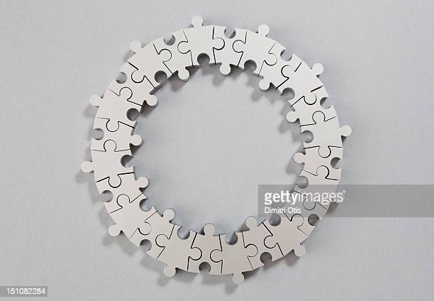 Round silver loop, circle shaped puzzle, complete