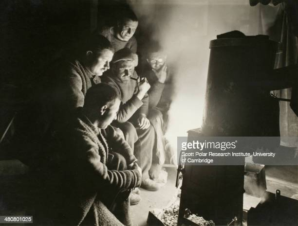 Round the night watchman's fire during the Imperial TransAntarctic Expedition 191417 led by Ernest Shackleton