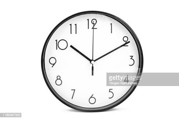 round wall clock isolated on white background - uhr stock-fotos und bilder