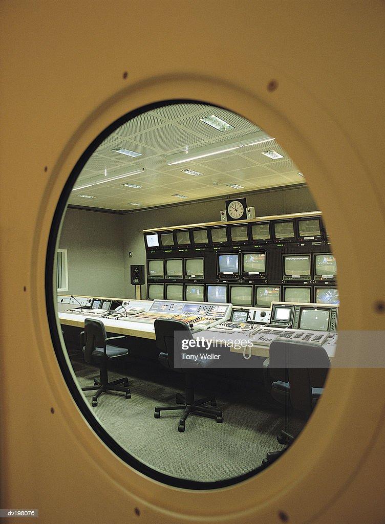 Round window in door of control room : Stock Photo