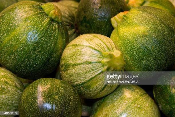 Round zucchini are pictured at the fruit and vegetable department of an 'O Marche' supermarket in SaintFrancois on the French overseas territory of...