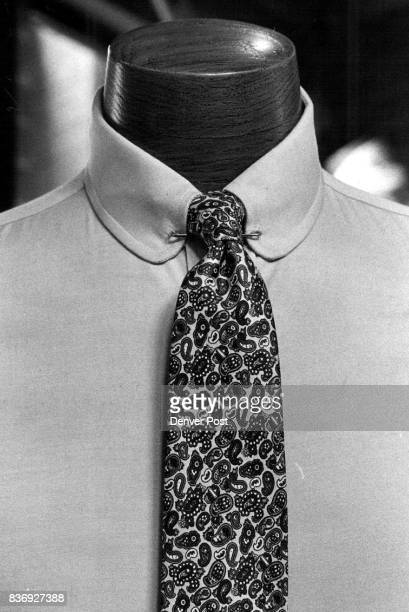 RoundAbout Approach Tired of buttondowns Don't like spread collars that can point up and look asymmetrical Try this changeofpace roundedeyelet collar...