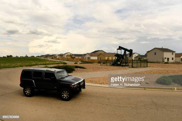 A roundabout on Flying Circle Blvd was constructed to go around an oil derrick near a housing development on June 7 2017 in Dacono Colorado Gas and...