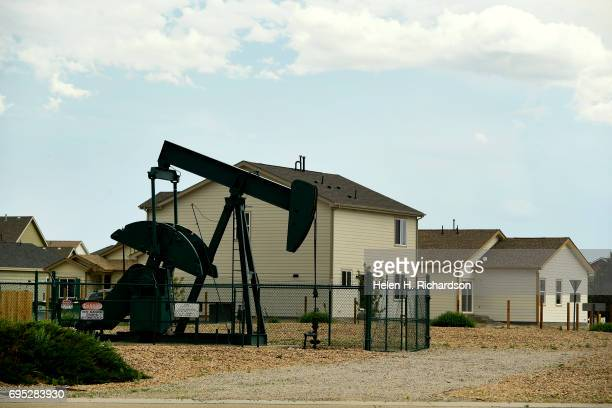 A roundabout on Flying Circle Blvd was constructed to go around an oil derrick that sits inside a housing development on June 7 2017 in Dacono...