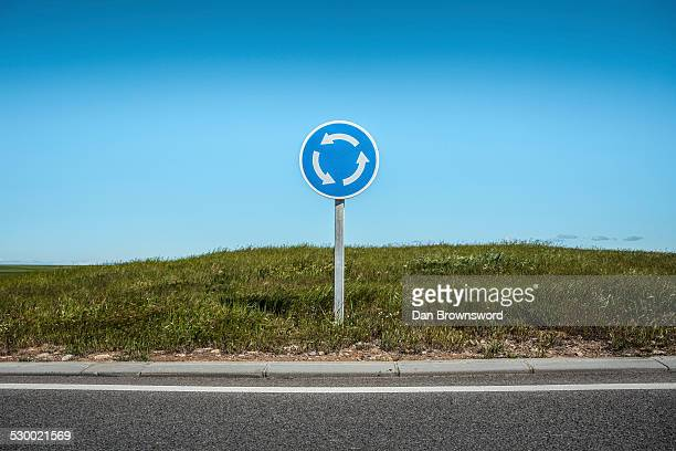 Roundabout sign by edge of road