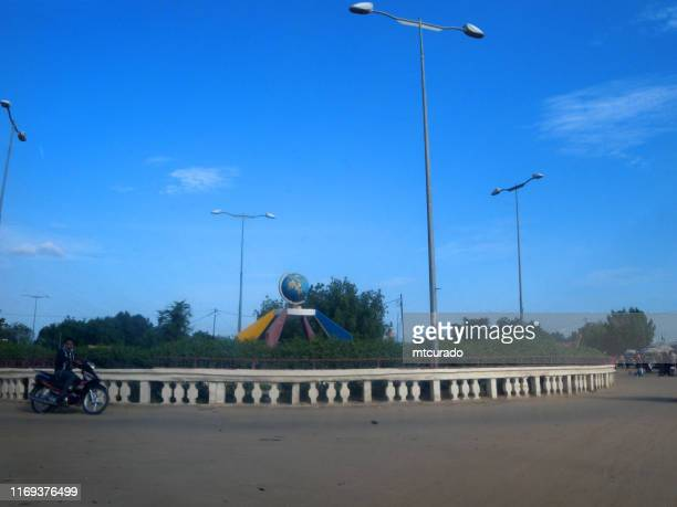 roundabout with globe, n'djamena, chad - chad stock pictures, royalty-free photos & images