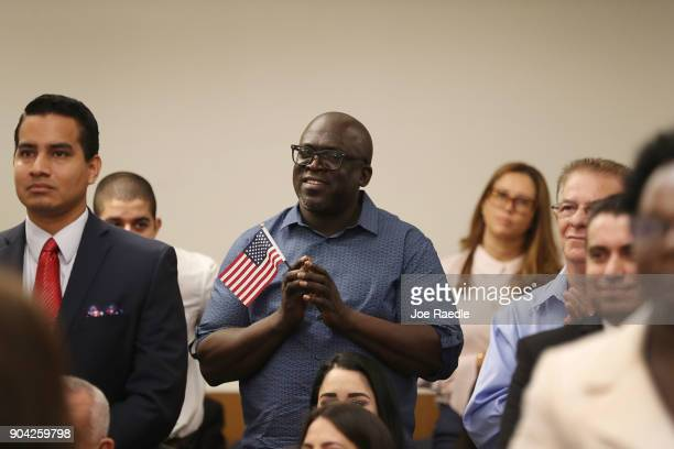 Roundel Semple orginally from Guyana becomes an American citizen during a US Citizenship Immigration Services naturalization ceremony at the Hialeah...