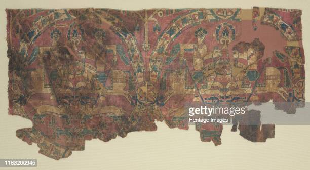 Roundels with hunters, 800s. These textiles are woven with floral roundels that enclose horsemen hunting lions. The theme of horsemen hunting with...