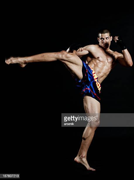 roundhouse kick - muay thai stock pictures, royalty-free photos & images