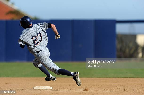 rounding second base - baseball player stock pictures, royalty-free photos & images