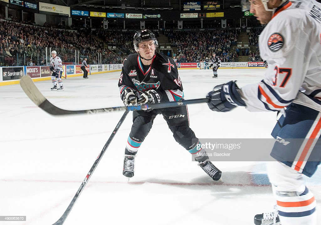 Rourke Chartier #14 of the Kelowna Rockets skates in for the check against Patrik Maier #37 of Kamloops Blazers on September 25, 2015 at Prospera Place in Kelowna, British Columbia, Canada.