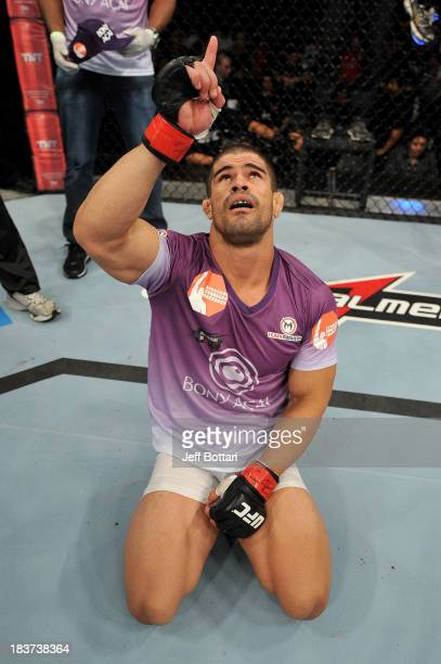 Rousimar Palhares celebrates after defeating Mike Pierce in their welterweight bout during the UFC Fight Night event at the Ginasio Jose Correa on...