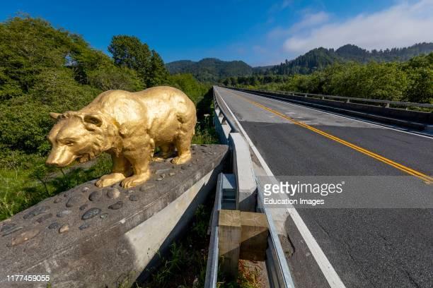 Route 101, Golden Bear Statue on bridge cross Klamath River, California.