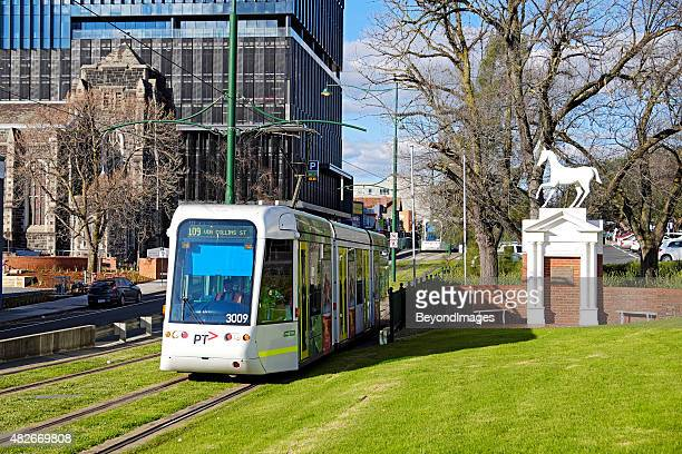Route 109 tram departing Box Hill with iconic White Horse