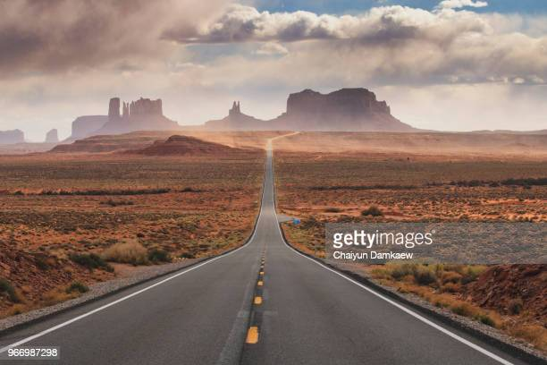 u.s. route 163, monument valley - road trip stock photos and pictures