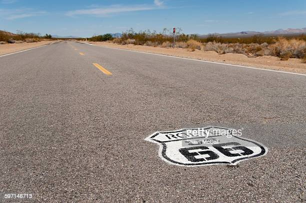 Route 66 highway sign painted on pavement