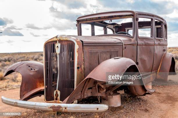 Route 66 Monument and 1932 Studebaker in the Painted Desert of the Petrified Forest National Park.